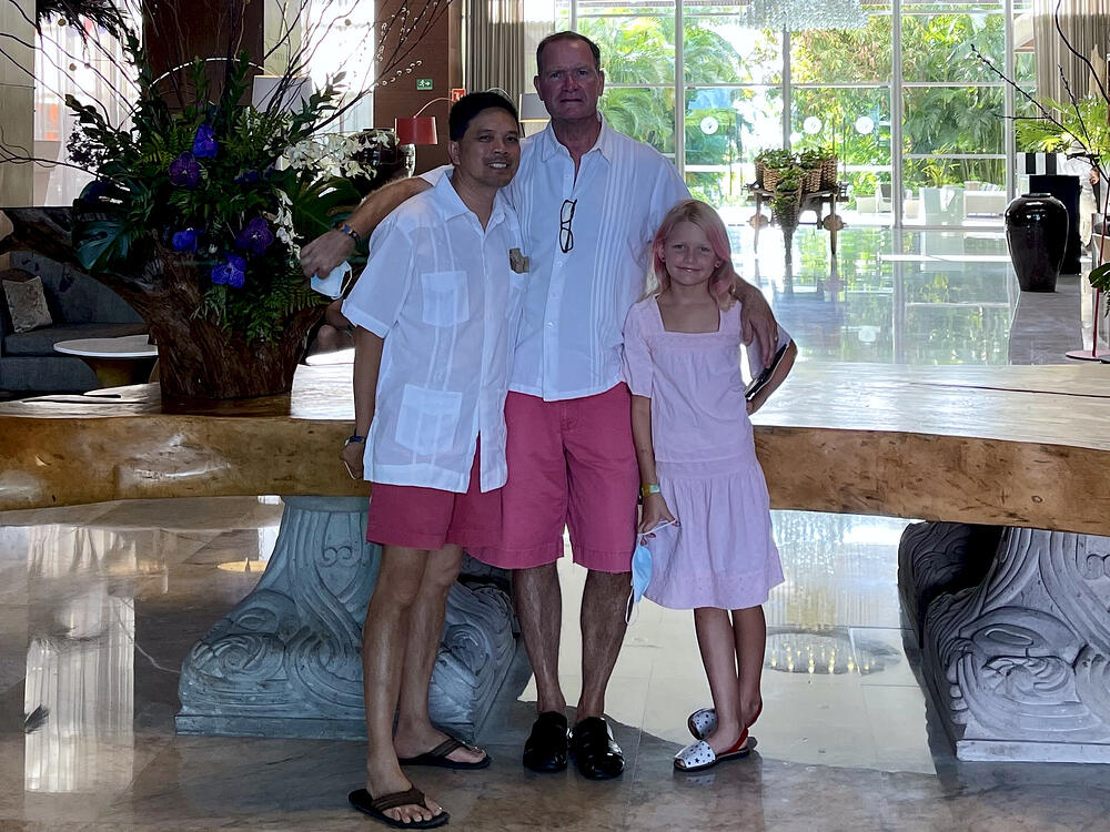 Two dads and their daughter on vacation in Puerto Vallarta