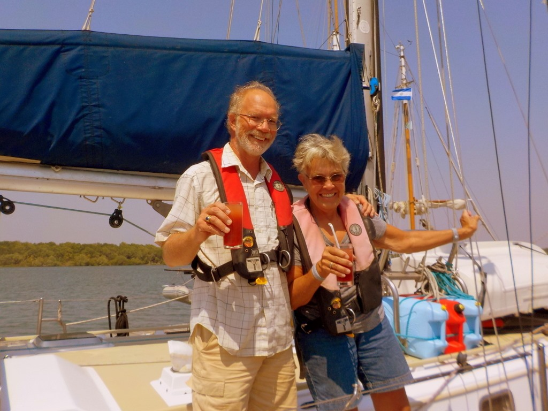 Liveaboard sailing couple on their sailboat in Bahia del Sol El Salvador