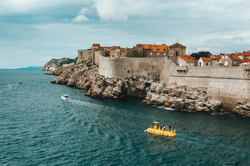 Travel the wold by cruise to see historic coastal towns with walled cities by sea