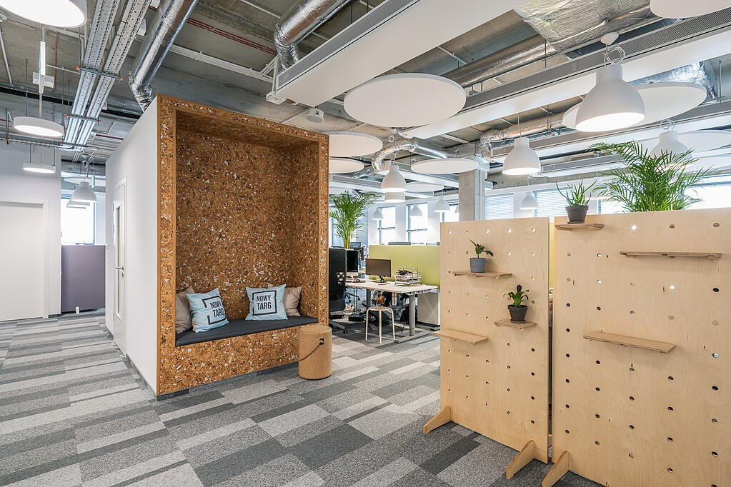 Condo ship offices in Europe with seating areas and work stations
